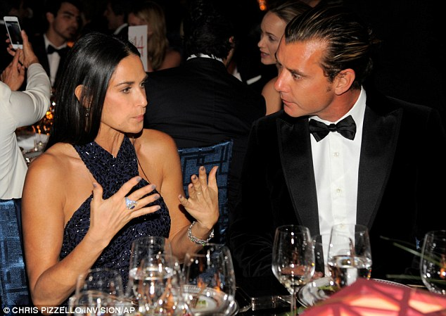 Animated conversation: The 50-year-old actress expressed herself with her bejeweled hands as she talked to Gwen Stefani's husband, Gavin Rossdale