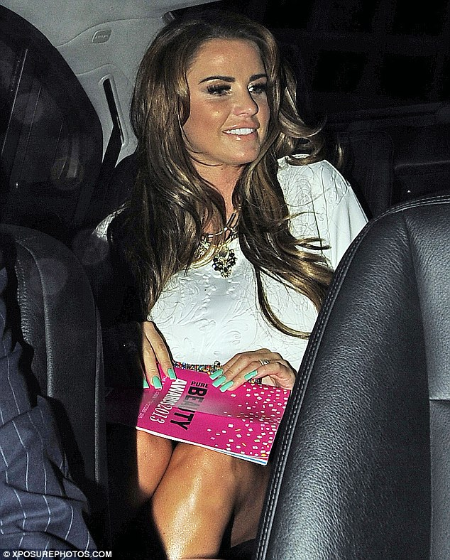 Celebrating: Katie beamed as she left the Savoy Hotel after picking up an award for her fragrance Kissable