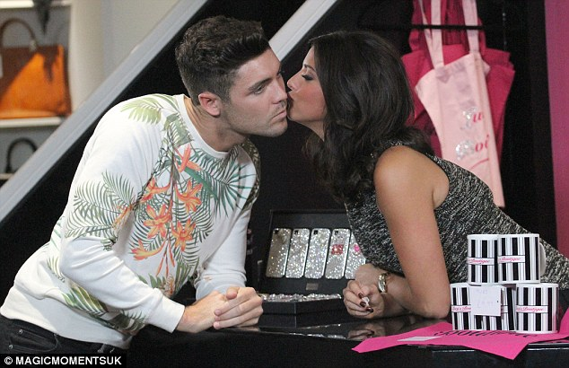 Showing her affection: Lucy greets her new beau Tom with a peck on the cheek
