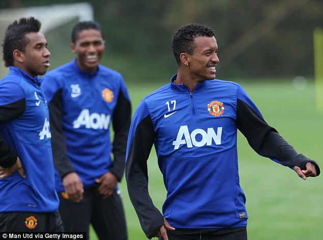 Laugh a minute: Nani was also involved in the joke, though United's league form so far this season has been no laughing matter
