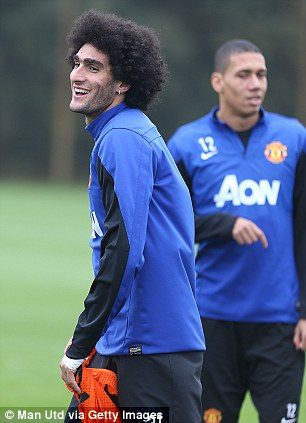 Searching for form: Marouane Fellaini keeps his eye on the ball in training