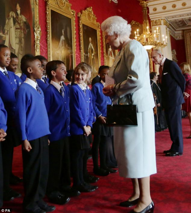 Performance: Children from the choir of St Winefride's School sung for the guests at the event