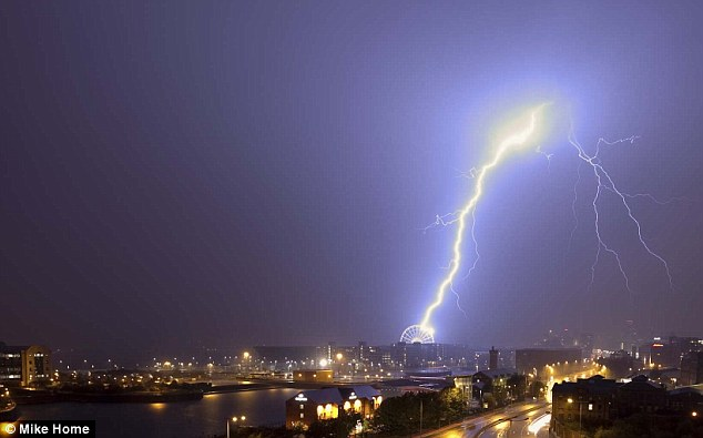 Strike: A lightning bolt hits the big wheel in Liverpool, in this dramatic image