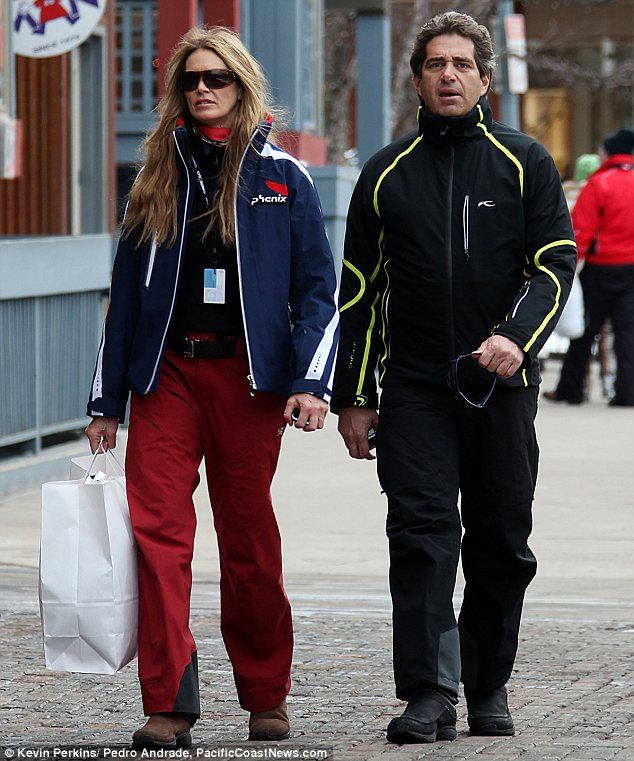 Newlyweds: Aussie Supermodel Elle Macpherson and now-husband, billionaire property developer Jeffrey Soffer, go Christmas shopping during a trip to Aspen, Colorado, in December 2009. They married in Fiji in August