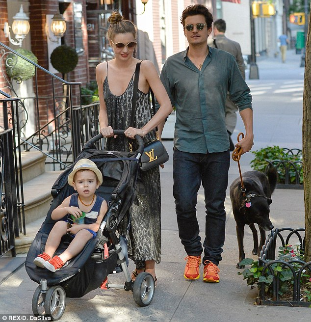 Family matters: Miranda is seen with husband Orlando Bloom, son Flynn and their dog in New York City on the Fourth of July