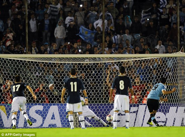 Hot shotL Luis Suarez scores against Argentina
