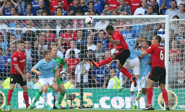 Lift off: Cardiff striker Fraizer Campbell scores against Manchester City