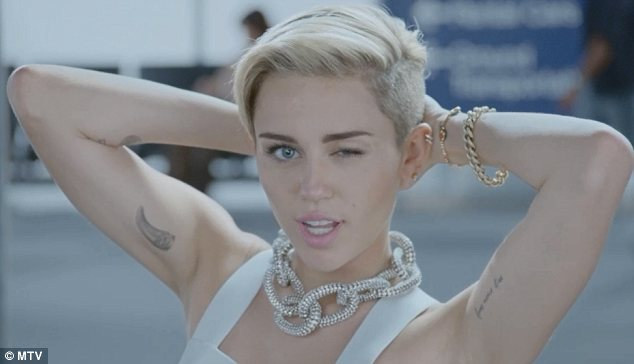 Saucy: Miley, who will also be performing at the awards show, gives a wink to the camera