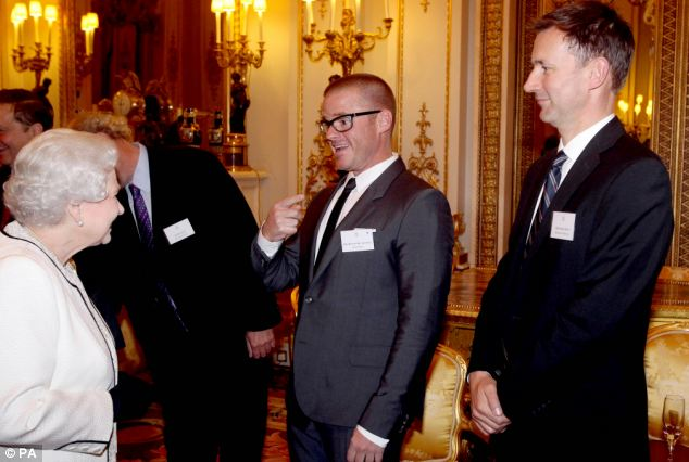 Ambitious: Heston, pictured with Jeremy Hunt at a Buckingham Palace reception last year, taught himself to cook and aged 15 translated a french cookery book word by word using a dictionary so he could make the recipes