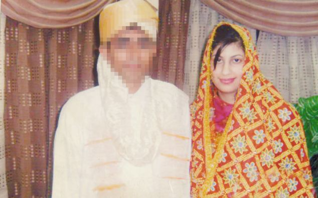 Same clothes: The traditional dress was the same in Sabah Qureshi wore as she smiled with her new 'husband'