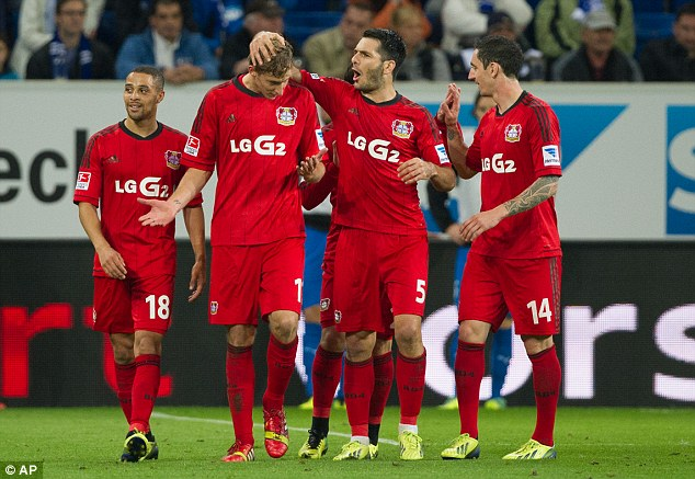 Embarrassed: Kiessling (second left) is congratulated by team-mates despite not knowing how the ball went in the net