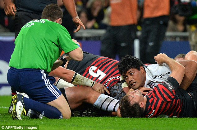 Going over: Christopher Tolofua, right, scores Toulouse's first try against Saracens