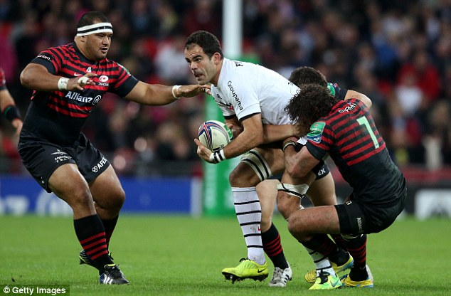 Needing help: Toulouse's Gregory Lamboley looks to offload before being hauled down
