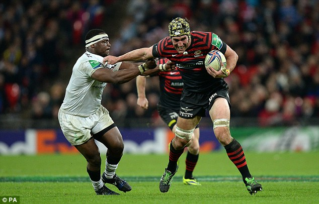Heavyweight clash: Saracens' Kelly Brown, right, hands off Toulouse hooker Chiliboy Ralepelle