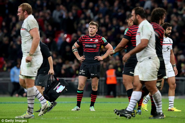 Look of defeat: Saracens' Owen Farrell takes in the pain of the loss to Toulouse