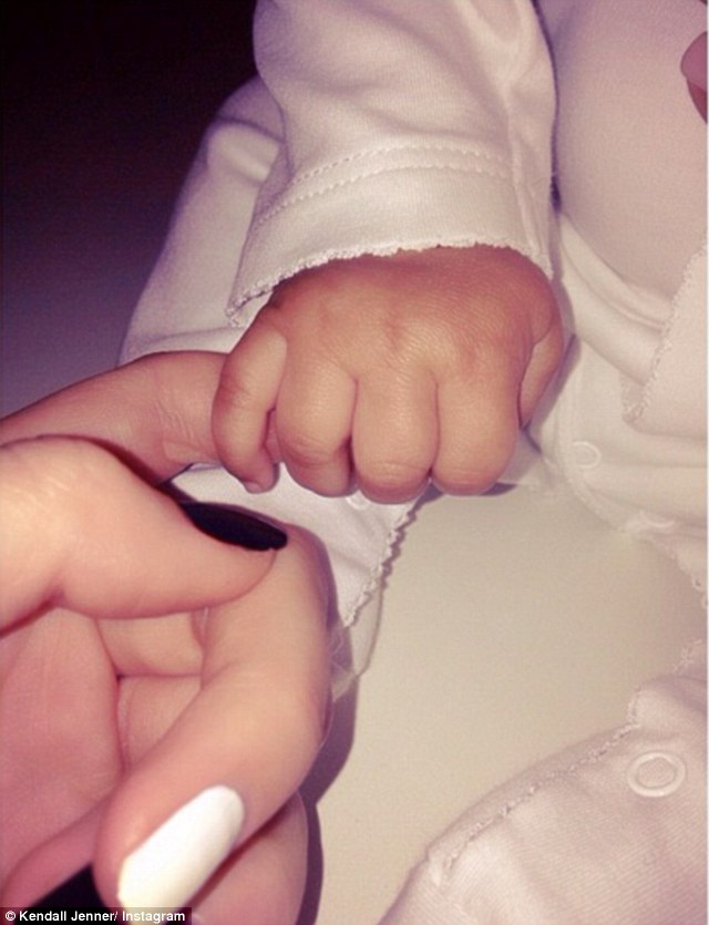 Baby North West? Kendall Jenner tweeted a picture of a baby's hand and wrote 'roommates and best friends'