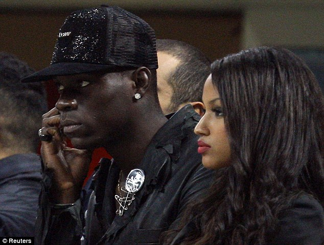 Star couple: Mario Balotelli, missing through injury, watched the game with girlfriend Fanny Neguesha