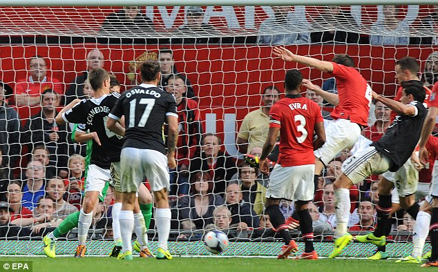 Scramble: Lovren almost followed up his winner at Anfield with a late equaliser at Old Trafford on Saturday