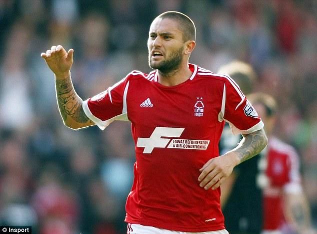 Match winner: Henri Lansbury celebrates scoring the only goal of the game for Nottingham Forest