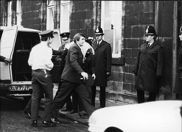 Peter Sutcliffe, the Yorkshire ripper, is led into Dewsbury magistrates court where he was committed for trial at Leeds Crown Court for murder