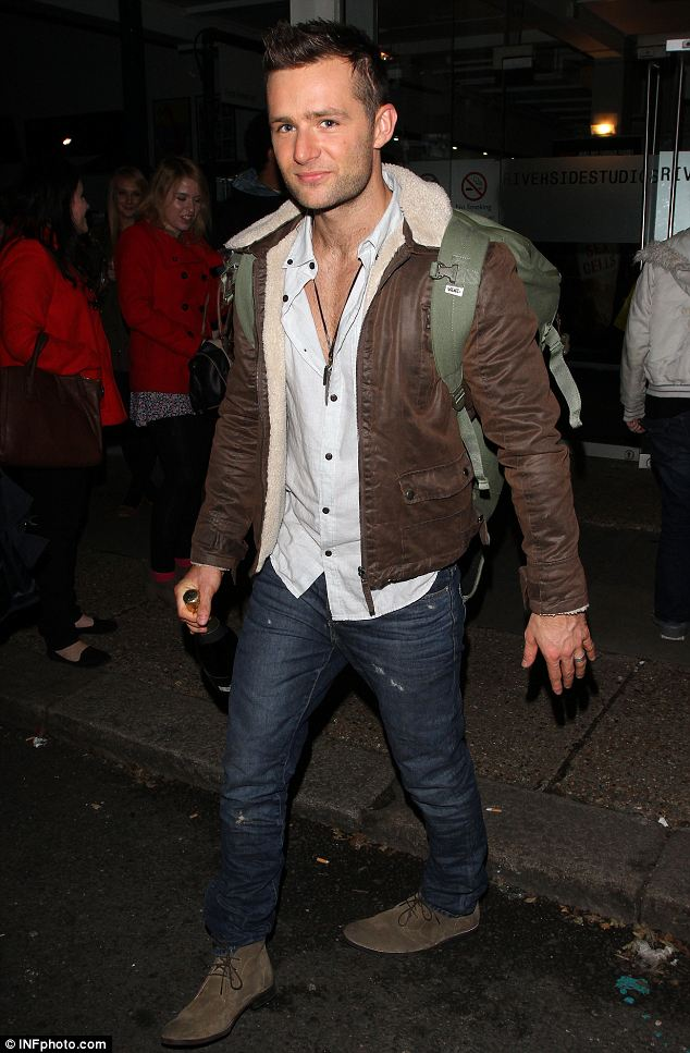Casual: McFly singer Harry Judd wears a tan leather jacket,a white shirt and scruffy jeans as he leaves the studios