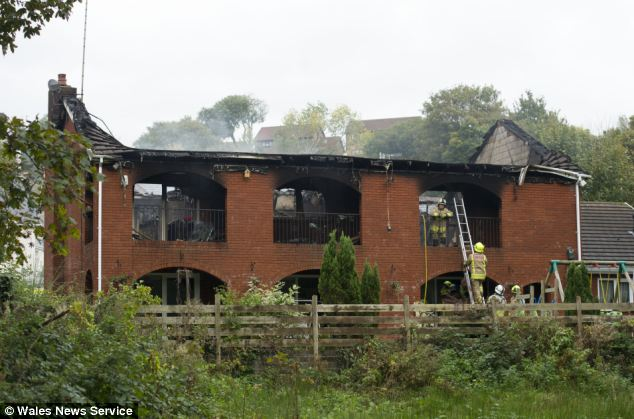 A teenager has died after fire tore through her grandparents' home. The five-bedroom property, pictured, in Abernant, near Aberdare in south Wales was destroyed by the blaze