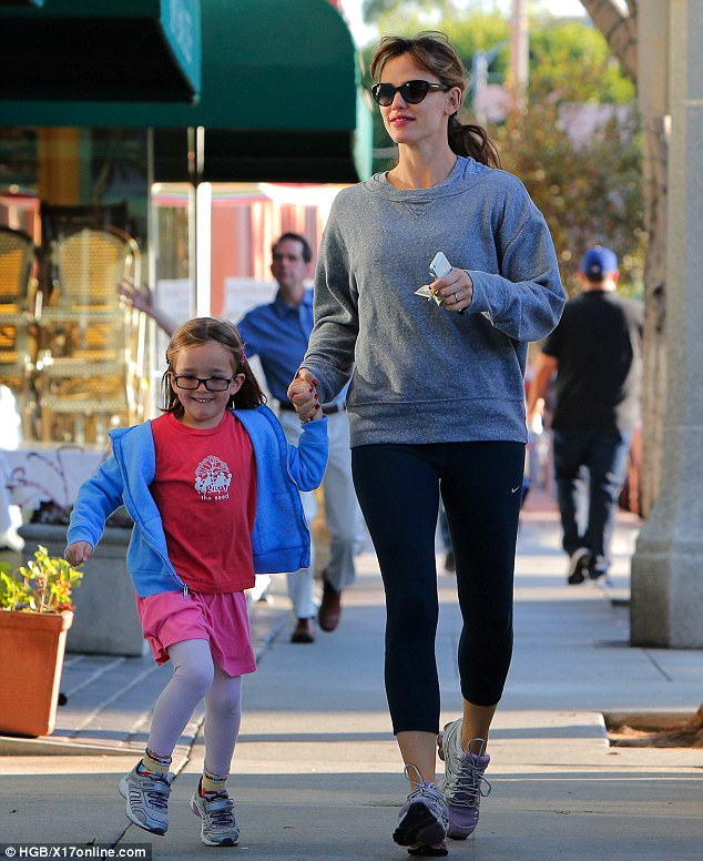 Getting in on the action! Jennifer Garner and daughter Violet are photobombed by a random man who plays up to photographers