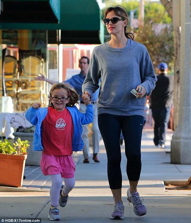 Wave your hands in the air! As the youngest daughter of Ben Affleck and Jennifer Garner raises her hands in delight so does her photobomber who waves at the cameras