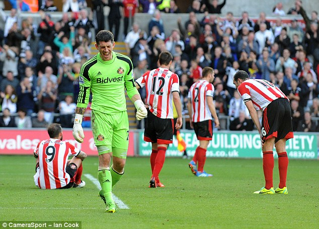 Thrashed: Keiren Westwood looks distraught as Sunderland capitulate at the Liberty Stadium