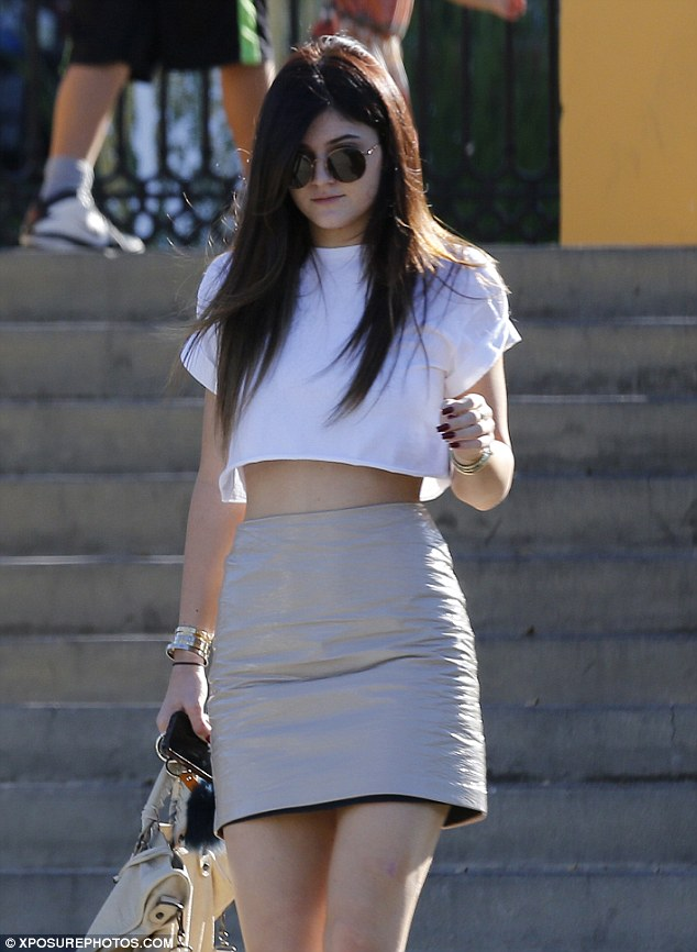 Growing up fast: Kylie Jenner donned a less than age-appropriate nude leather mini-skirt on Saturday to hang at her home away from home - the Commons in Calabasas