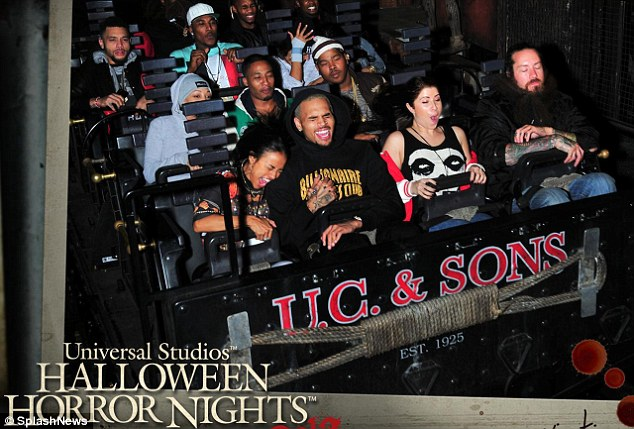 Weee! The 25-year-old model clenched on to the 24-year-old singer's hand as they both screamed during their final descent on the spooky roller-coaster