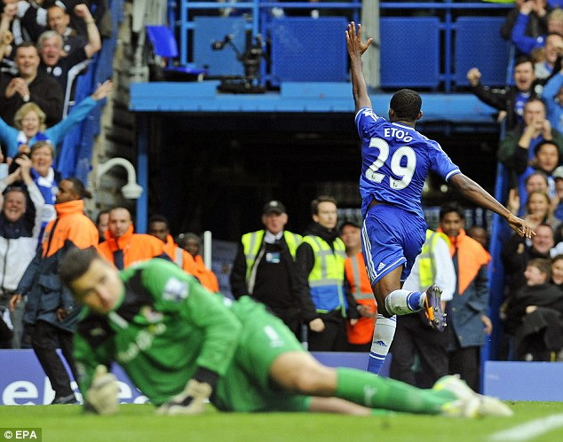 One for me: Eto'o wheels away after scoring a goal of his own as Chelsea cruised to victory