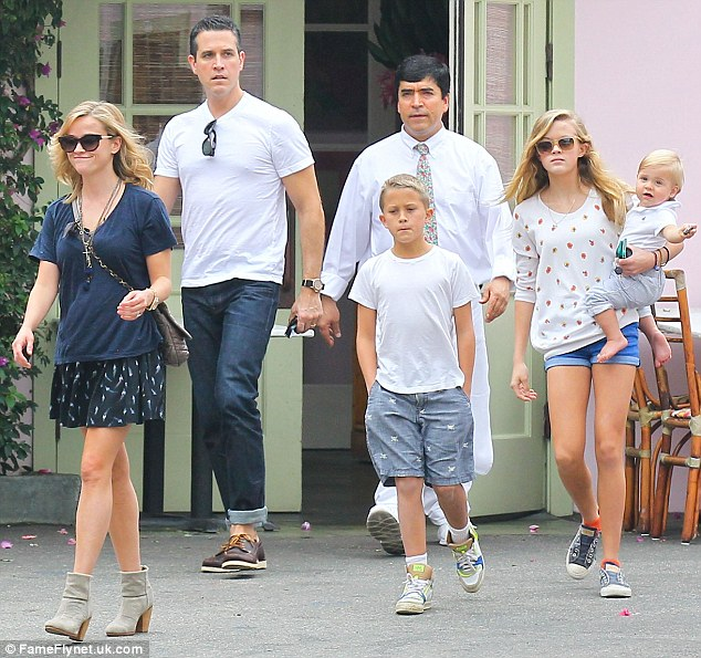 Happy days: Reese smiled in the company of her children and husband as they left the expensive eatery