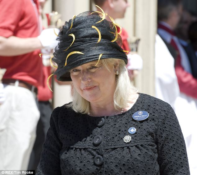 New model: The Queen's dressmaker Angela Kelly, pictured at a church service in Canada, created the new replica of the christening gown