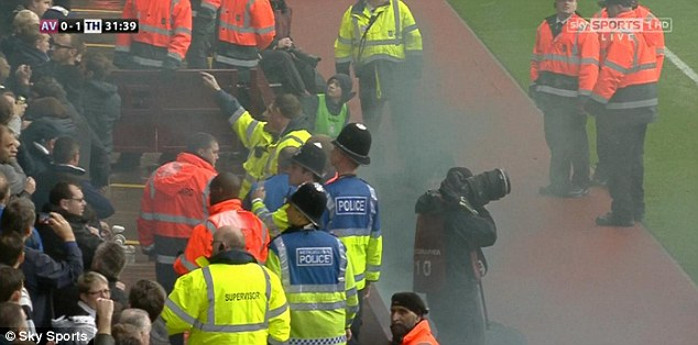 Removed: Police appeared to remove a member of the crowd, with the FA likely to investigate the incedent