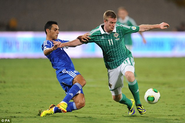No chance: Chris Brunt and Northern Ireland were also way off the pace
