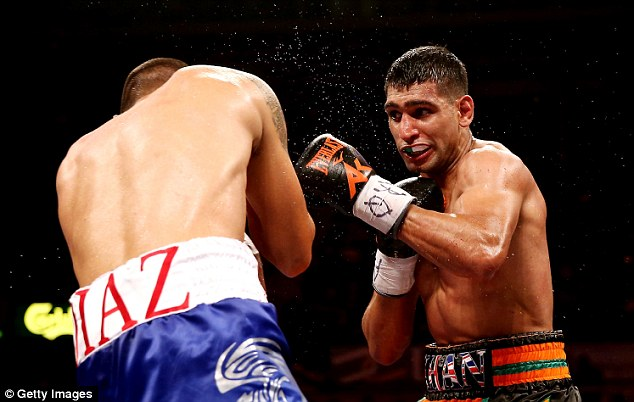 What's missing? Amir Khan (right) is one of a number of successful British-Asian sportspeople