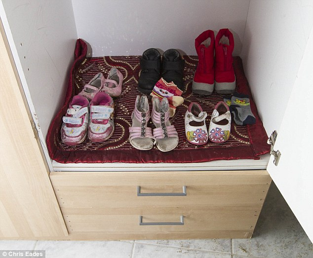 Seen: A cupboard, again the only one in the house, contained two rows of little girl's shoes and other clothes