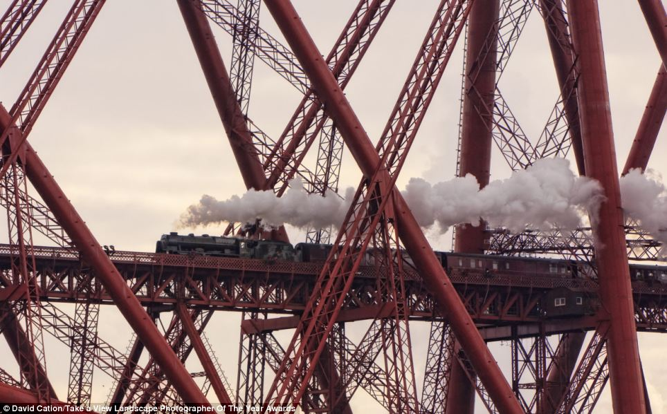 Steam and iron: This photograph, called Caught in a Web of Iron, was taken in North Queensferry, Fife by David Cation and won the Network Rail 'Lines in the Landscape' award