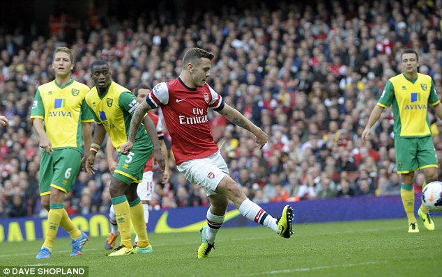 Great move: Jack Wilshere finished off a stunning team move to put Arsenal in the lead against Norwich