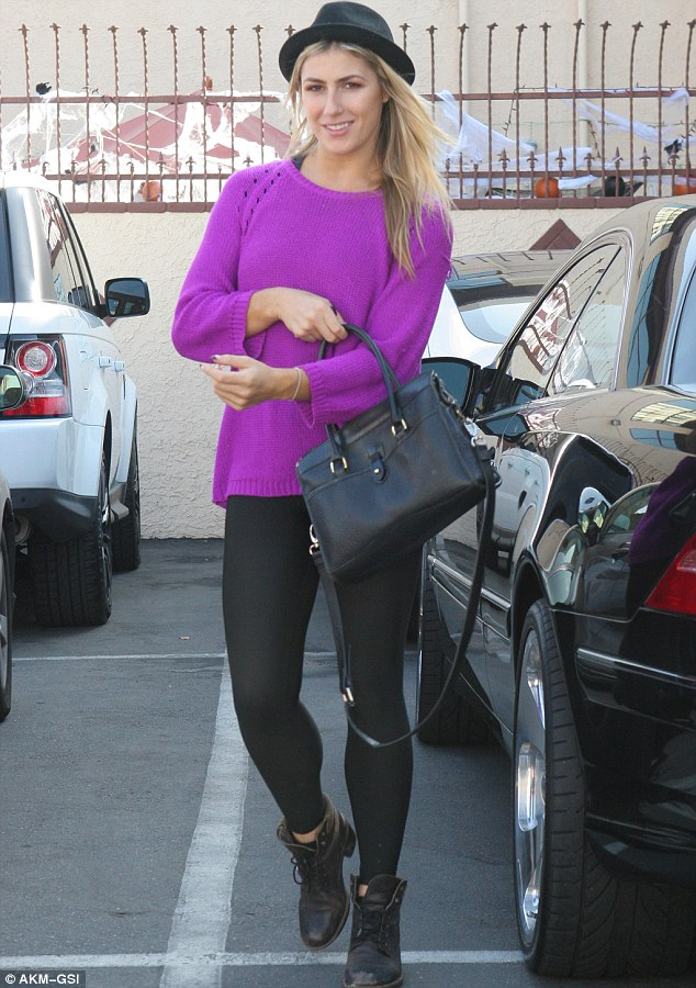 Cover up: The English hoofer wore a fuchsia sweater over her crop top at one point