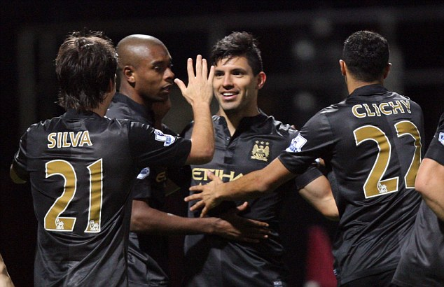 City slickers: Sergio Aguero celebrates scoring his sides second goal