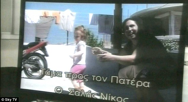 Exploited: Eleftheria Dimopoulou, 40, is pictured with little Maria in a video shot two years ago