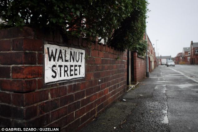 Wrong house: Workers broke into the wrong house in Walnut Street in Gorton, Manchester, which was just yards away from the correct house after 'misreading' the number