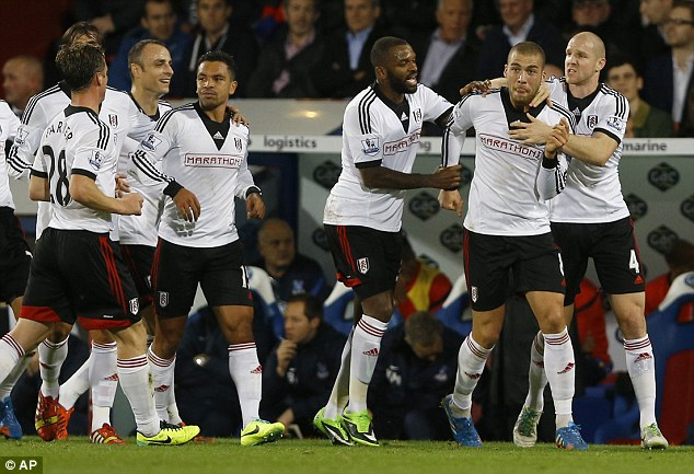 Brilliant: Fulham players rush to Kasami after the brilliant goal