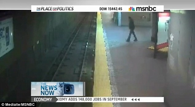 Awkward: MSNBC announced the engagement of Kayne West and Kim Kardashian but showed footage of a woman who fell off a train platform