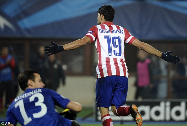 At the double: Diego Costa scored twice on his Champions League debut for Atletico Madrid