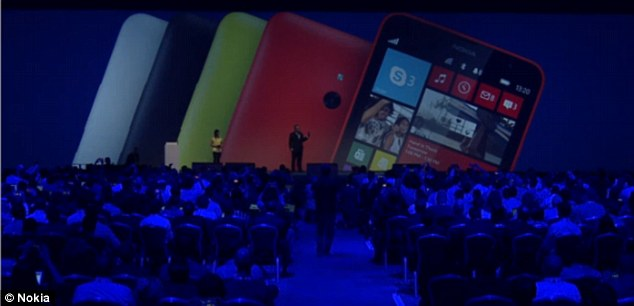 A cheaper, 6-inch model called Lumia 1320, pictured on the screen at the Nokia World event in Abu Dhabi, was also announced, with a 720p screen and 5MP camera.
