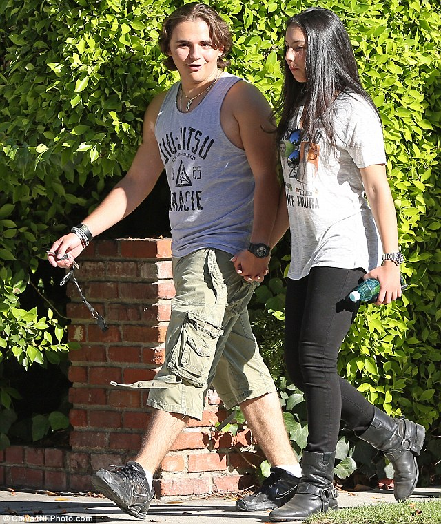 Holding hands: Prince Jackson and his girlfriend Remi Alfalah held hands on Monday as they walked to a farmers' market in Beverly Hills, California