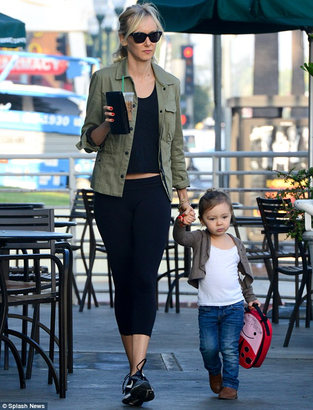 Pre-school fix: Kimberly picked up an iced coffee before dropping off her two-year old daughter at kindergarten